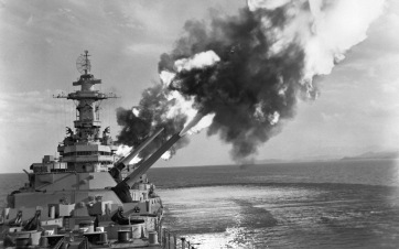 The USS NEW JERSEY (BB-62) fire a six gun salvo of 16 inch shell into enemy troop concentration near Kaesong, Korea. NARA FILE #: 80-G-433953