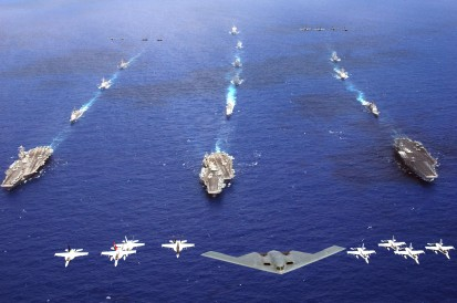 A B-2 Spirit and 16 other aircraft from the Air Force, Navy and Marine Corps fly over the USS Kitty Hawk, USS Ronald Reagan and USS Abraham Lincoln carrier strike groups in the western Pacific Ocean on Sunday, June 18, to kick off Exercise Valiant Shield 2006. The joint exercise consists of 28 naval vessels, more than 300 aircraft and approximately 20,000 servicemembers. (U.S. Navy photo/Chief Photographer's Mate Todd P. Cichonowicz)